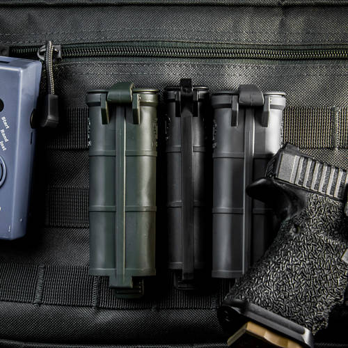 Three CellVaults, two XL and one original size, mounted to MOLLE alongside other accessories