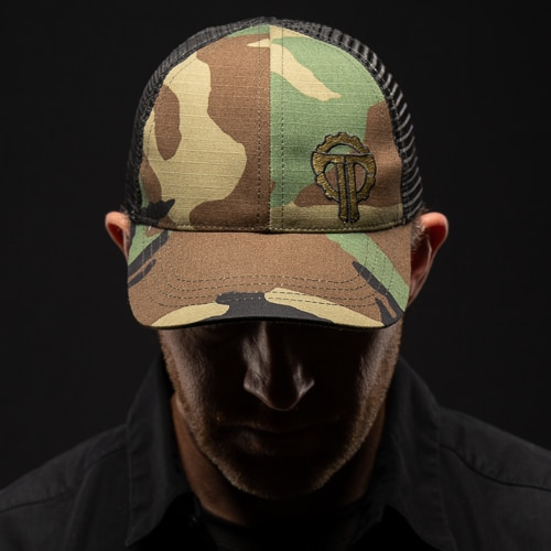 Woodland Camo Hat has a large embroidered Thyrm Logo