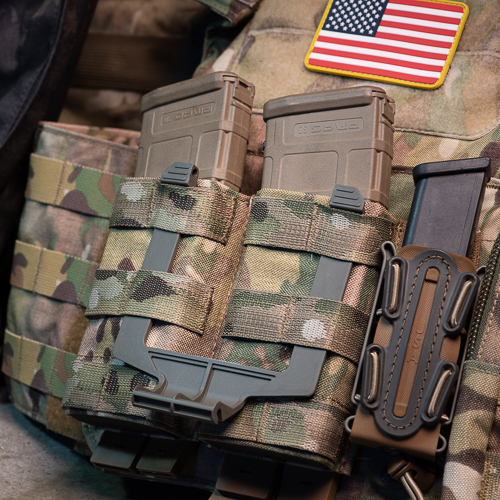 The DarkVault Critical Gear Case mounting bracket can stay mounted on MOLLE when the DarkVault is removed