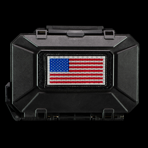 DarkVault Comms Critical Gear Storage holding a USA patch on its outer velcro