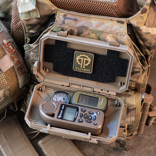 DarkVault Critical Gear Storage holding a map system, GPS, compass, and patch
