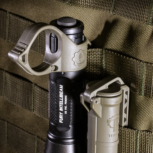 Olive Drab CellVault and SwitchBack Large 2.0 mounted on MOLLE